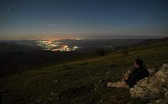 Mike Reva posted a photo:  canon5d2+samyang24mm f2.8 iso 500 10s  Our first night spent in Crimean mountains, during this years may trip. The moon being close to full phase is killing the stars but not the lights of night Simferopol.  Was such a great time, spent there. We were watching planes taking off and landing, seen just as far spots of light, we turned on some music.... that was just the beginning of our trip and so many things were still to happen... =] i definitely miss this place…