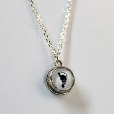 footprint in silver necklace