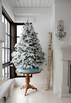 I ♥ flocked trees!  The homeade method is super easy and inexpensive!  I used soap shaving and water, wisk together.  Brush on branches.  Don't make the mistake of using a scented soap like I did;-)
