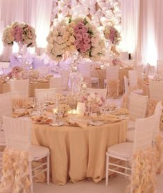 Gold, ivory and blush colored wedding reception decor.