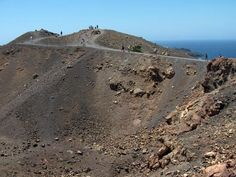 Climb a Volcano- done! Climbed the caldera in Santorini on our honeymoon.