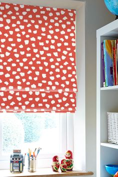 Add a real splash of colour with our Etta Firefly Roman blind. Featuring a rich ruby red background with irregular white spots it's the perfect choice for making a statement within any room.