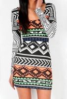 Stunningly rad Neon Tribal Bodycon Dress by Australian label Reverse. Features back elastic straps and slim body con fit. Goes perfect with sky high platforms.    100% cotton  Imported    $61