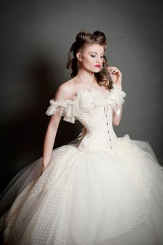 Bridal ivory duchess satin and trimmed with a soft dot tulle around the bust and shoulders worn here with a tulle skirt