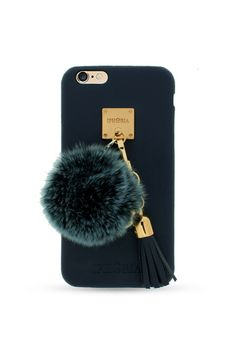Never lose your phone in a bottomless bag again with this chic pom-pom case with gold details.  iPhoria Blue Fur Lining Case, $100; shop.iphoria.com.