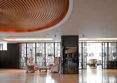 The Pavilion Hotel also has a creative lobby with orange and golden touches that contrast with the black walls and beige floors Hotel Hotel Canberra, World Architecture Festival, New Nordic, Interior Design Awards, Hotel Lobby, Black Walls, Beautiful Space, Best Interior, Art Deco Fashion