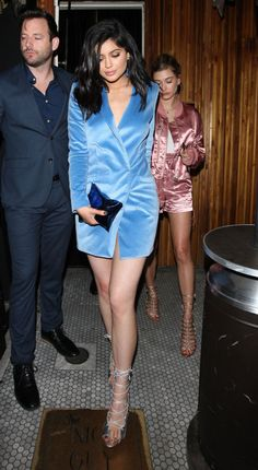 A bright blue fuzzy coat and who knows what (if anything!) underneath.