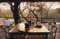 Breakfast in the bush. The deck at the Royal Malewane Lodge in South Africa.