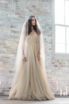The MinkMaidsCollection has done it again with this amazing gold shimmer wedding dress made with metallic tulle and 100% silk crepe de chine.
