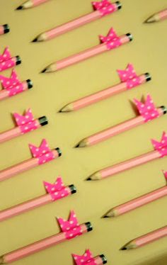 spray paint the pencils to cordinate with the party theme.....so simple, and yet I look for 'color' pencils all the time!  Golf pencils are so cheap in bulk!!!