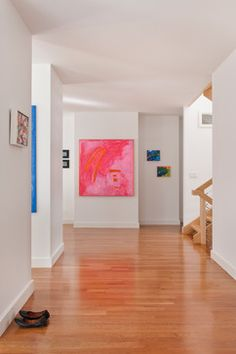 Big bold art on white walls. I want pink art for the powder room.