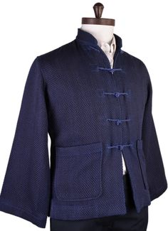 Luxire Indigo Heavy Sashiko Jacket: http://luxire.com/products/indigo-heavy-sashiko-jacket  Consists of Mandarin collar, 5 knot closure on the placket and 2 patch pockets.