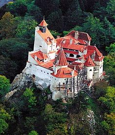 "Bran Castle is situated near Bran and in the immediate vicinity of Brasov; it is a national monument and landmark in Romania. Commonly known as ""Dracula's Castle"", it is marketed … Castle In The Sky, Bran Castle Romania, Romanian Castles, Famous Vampires, Dracula Castle, Transylvania Romania, Beautiful Castles, Beautiful Places, Medieval Castle"