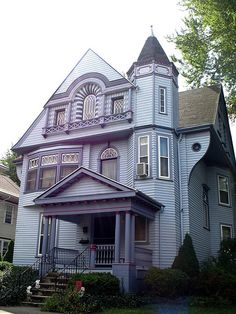 Strange, offputting color combination on a Queen Anne in Bowling Green OH, photo by buckeye616 via Flickr. The body color is really nice, and I like lavender but together? The window panes and decorations on this house are charming.