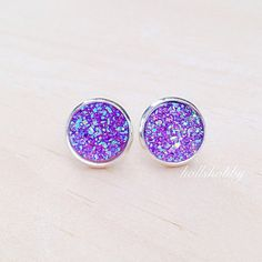 A beautiful pair of handcrafted purple druzy inspired earrings. Purple themed wedding? These would be great for the bride, bridesmaids and flowergirl! Also a great gift for women, girls, and teens for Christmas, Easter, Mother's Day, etc.... Available on Etsy.