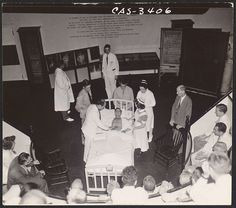 Dr. Greene Fitzhugh (hands on chair) watching as patient is examined during lecture demonstration at Massachusetts General Hospital,	 1944.  Francis A. Countway Library of Medicine. Center for the History of Medicine.   http://nrs.harvard.edu/urn-3:HMS.Count:med00016