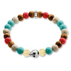 Stretch-style favourite: Worn solo as an eye-catcher or in combination with other bracelets, the Rebel at Heart stretch bead bracelet is breath-taking with a colourful material mix featuring tiger's eye, jasper, natural agate, treated red bamboo coral, imitation turquoise and skull as a highlight in blackened 925 Sterling silver.