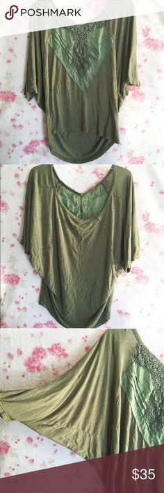Free People Green Loose Blouse 🌸 A green loose fitting, hi low, oversized shirt by Free People   🌸Sleeves are loose and then tight around the end of the sleeve, almost like a Dolman sleeve  🌸 Has lace detail, and the fabric around the lace is slightly sheer   🌸 Has minor piling throughout the cotton portion of the shirt   🌸 I can't read the size on the label, but should fit a medium Free People Tops Blouses