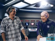 Director Dean Parisot and Alan Rickman on the set of 'Galaxy Quest' (1999). (Photo credit DreamWorks)