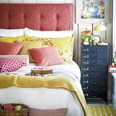Bedroom Ideas: Cottage Style Bedroom with Reused Blue Drawer also White Wood Panel plus Tufted Red Headboard and Yellow Floral Cushions