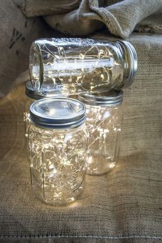 Wide mouth Mason jar fairy lights. Perfect table decor for rustic weddings! www....