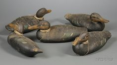 Five Mason Standard Glass Eye Black Duck Decoys, Mason's Decoy Factory, Detroit, Michigan, early 20th century, with inset glass eyes, painted nostrils and nail, weighted, (two with shrinkage cracks, paint wear), ht. 7, lg. 15 5/8 in.  one has a small 1/2 in. chip on the tail.  Sold for $ 2,607