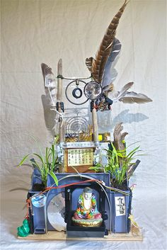 "Buddhist Shrine, Front View,  Made From Salvaged Electronics Parts, Camera Optics, Feathers, Upcycled Asian History Book Illustrations, Beaver Dam Sticks (With Teeth Marks!), and Too Much More to list!  Approximtely 20"" tall. $250"