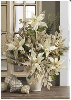 Winter's Lace Floral Arrangement. Like this idea for Christmas season into January.