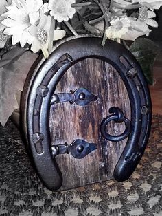 I make these doors from used horse shoes, hand forged hardware, and repurposed items. 5 inches tall and 4 inches wide. All your wee folk will Horseshoe Projects, Horseshoe Crafts, Horseshoe Art, Horseshoe Ideas, Used Horse Shoes, Fairy Village, Deco Nature, Equestrian Decor, Horse Crafts