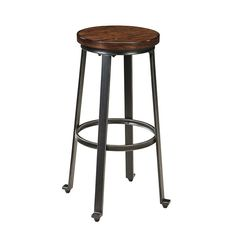 The rich rustic design of the Challiman Bar Tall Stool by Signature Design by Ashley Furniture features the Vintage Casual look of the deep brown finished chair seat accented with rough sawn details, beautifully supported with a bar shaped tubular metal base, bathed in a dark bronze color powder coat finish.