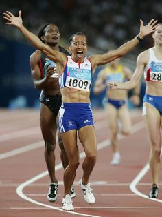 Inspirational Moments: Olympic celebrations - ATHENS - AUGUST 23: Kelly Holmes of Great Britain celebrates after she won gold in the women's 800 metre final on August 23, 2004 during the Athens 2004 Summer Olympic Games at the Olympic Stadium in the Sports Complex in Athens, Greece. (Photo by Stu Forster/Getty Images)