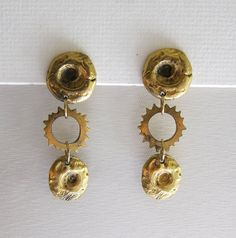Vintage 1980s retro cast brass gold tone aztec sun drop earrings