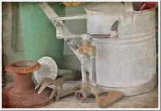 old rusty tin...metal...garden pretties...sprinkler....watering can...love...