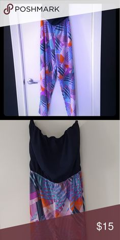 Multi color Wideleg Junpsuit Navy blue tube top, colorful bottom. Wide, flowy leg. Im 5'9 & this was long enough for me. Pants Jumpsuits & Rompers