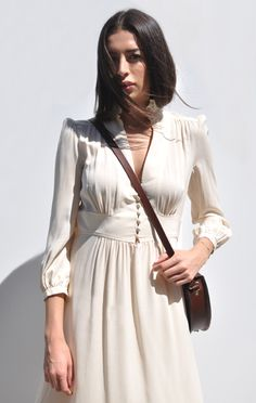This dress is so elegant. We love how it's been dressed down with the cross-body bag - total spring style inspiration.