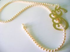 Necklace made of brass and white glass beads