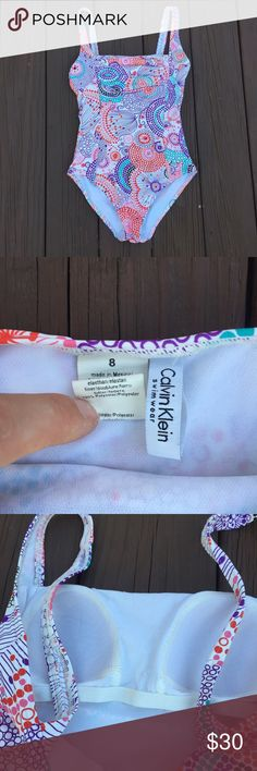 Calvin Klein 1 piece swimsuit Colorful patterned 1 piece swimsuit has built in bra (no underwire just stretchy) size is 8 but I feel it runs small and is better fir for a size 6 no flaws Calvin Klein Swim One Pieces