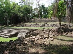 Visit the ancient Mayan city of Lubaantun in the remote southern district of Belize. Clilmb the crumbling steps and explore the shadowy crevices. Then enjoy a hike through the living jungle to the caves of Blue Creek where you will enjoy cave swimming in the cool mountain waters. #robertsgrove