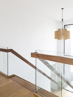 Refined and understated, Sommer Street makes home feel light and calm, with Spotted Gum treads and handrail, with glass balustrade. Timber Handrail, Glass Handrail, Timber Stair, Modern Stair Railing, Staircase Handrail, Stair Railing Design, Glass Stairs, Glass Balustrade, Modern Stairs