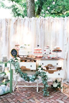 wedding dessert table with ribbon backdrop