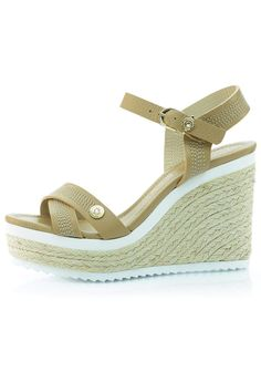 "This gorgeous wedge from Luis Onofre features Swarovski crystals at the toe and ankle, as well as raffia trim on the wedge. The color blocking of the tan leather, white accents, and beige raffia make this shoe super stylish. Contrast stitching on the crisscrossed toe and ankle straps brings some extra interest to the table as well.    The heel height is 4"" with a 1.5"" platform.   Tan Leather Wedge by Luis Onofre. Shoes - Wedges South Carolina"