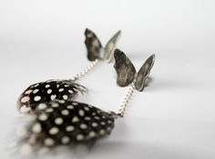 Butterfly and Guinea feathers in sterling silver