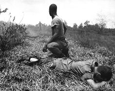 White phosporus booby trap casualty treated by medic in Vietnam 1966. A young American lieutenant, his leg burned by an exploding Viet Cong white phosphorus booby trap, is treated by a medic. ~ Vietnam War
