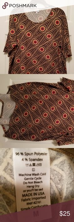 """LuLaRoe Irma Tunic - Size M (12-14) Brand new without tags - never worn.  Color is tan and black with burgundy circles and other designs.  Loose, knit, """"high-low"""" tunic, comfy design.  Fitted mid-length sleeves.  The extra length in the back makes it a great compliment for leggings. LuLaRoe Tops Tunics"""