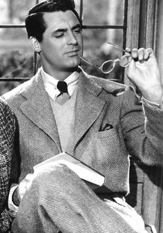 A studious looking Cary Grant. Is he pondering the chapter he just read in his book or is he wondering what's for tea?