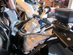 We love seeing people getting creative with the Quad Lock™ and when one of our customers got in touch and showed us his custom install we were pretty impressed! He modified the Quad Lock™ Bike Mount to fit the centre of his BMW R1200RT touring motorcycle. Here's how he did it: I trimmed off the curved bicycle mount, leaving a flat surface.  I then inserted a tube where the nut used to be. I needed the tube so that I could tighten down the screw through the mount, onto the motorcycle mount...