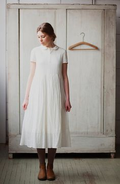White sleeveless underwear dress is made of soft light cotton. It might be worn under or on top of our classic dresses.  Most of our dresses are in stock, but some of them will be hand-made when ordered. Thus if your purchase is urgent, let's make sure we can deliver it on time! It might take us up to 4 weeks to produce, prepare and deliver your garment. The production process takes a while, because every dress is cut individually. From the sewing house it is brought to the softening house…