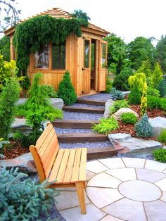 A pebbled pathway separated by layers of wooden steps that's lined with landscaped shrubs on the sides will lead you from the isolated wooden bench at the paved concrete flagstone to the inviting doors of the wooden gazebo at the top. Small Garden Landscape, Landscape Steps, Big Garden, Water Garden, Large Terracotta Pots, Wooden Garden Furniture, Wooden Gazebo, Wooden Steps, Wooden Cabins