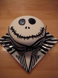 Jack from A nightmare before Christmas - My husband loves the movie A nightmare before Christmas! That is why I made him Jack. This is a chocolate cake with a layer of vanilla cake with salty caramel filling covered with chocolate ganache than with fondant. All details are fondant. He loves his cake and I love him!!!