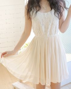 White dress for teenagers it is cute but i would probably spill ketchup or some unknown sauce on it